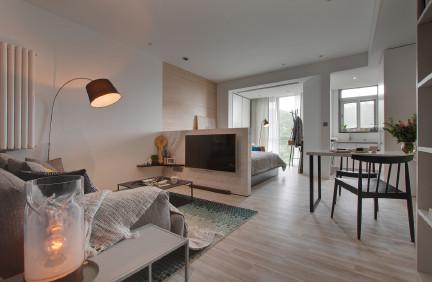 广华居简约设计,用半墙界定客厅卧室空间